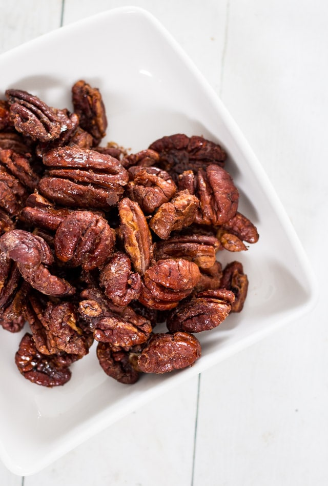 maple glazed pecans in a white serving dish