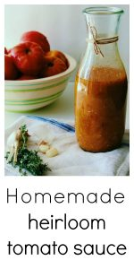 Heirloom Tomato Sauce in a large jar with fresh garlic and thyme scattered