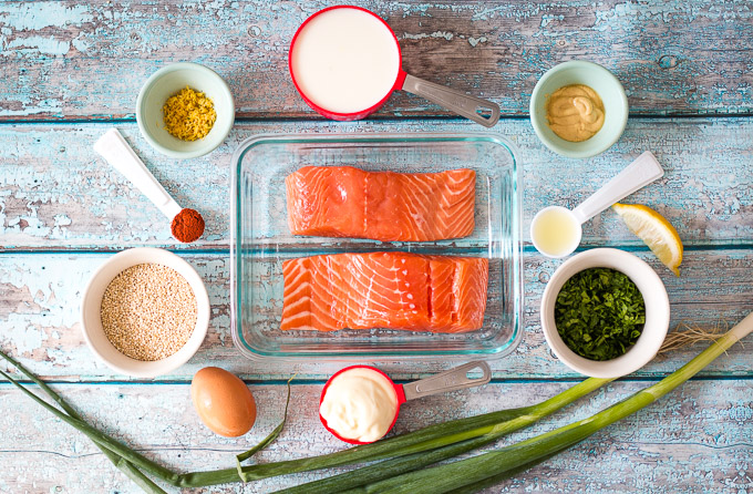 All of the ingredients required for easy salmon burger laid out in a flat lay style