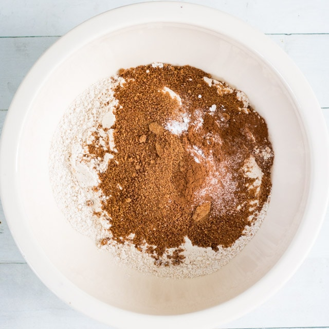 overhead shot of white bowl containing flour, coconut sugar, salt and cinnamon