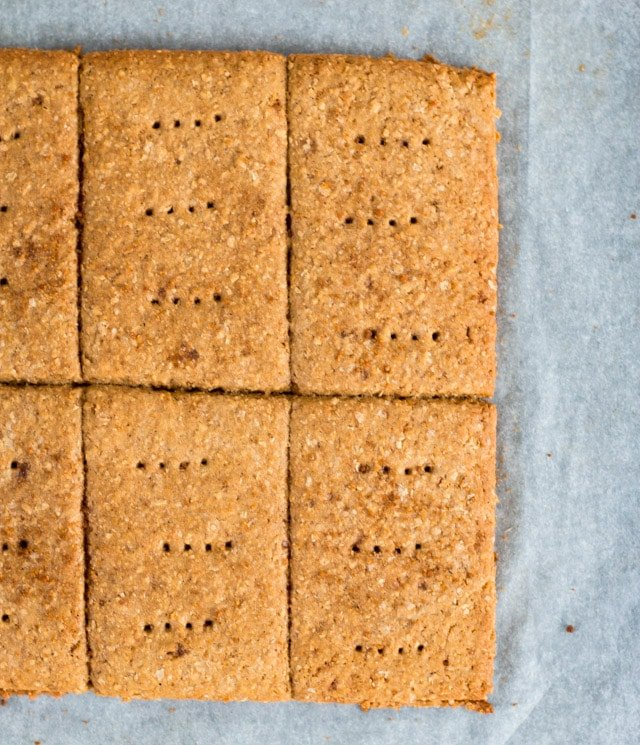 overhead close up shot of 6 vegan graham crackers on parchment paper