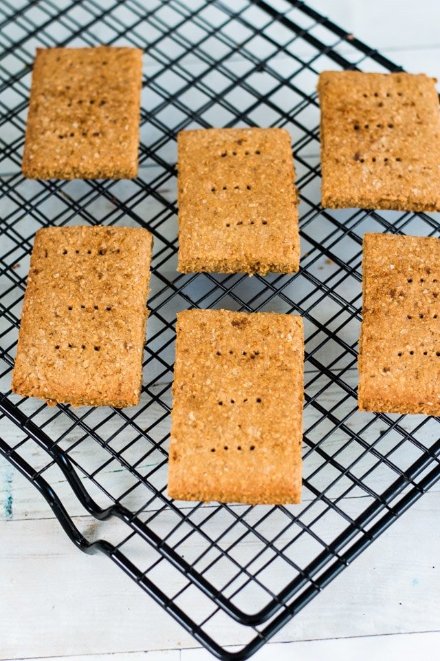 angled shot of graham crackers on a black cooling tray