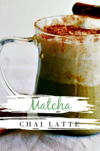 Green Tea Chai Spiced Latte in a clear mug with honey dripping down the side