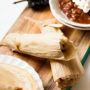 potato adobo tamales on a serving tray with a side of chili