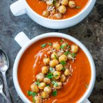 Instant Pot Creamy Roasted Tomato and Chickpea soup served in white bowls with lots of chickpeas piled on top of the soup
