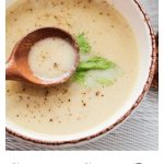 single bowl of cream of celery soup with celery leaf for decoration
