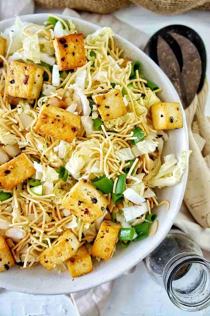 Up close shot of Crispy Tofu Fried Noodle Salad in a white bowl