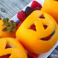 Orange Fruit Jack-O-Lantern - Directions for a Fun, Healthy Halloween