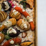 Garlic Hasselback Potatoes and Root Vegetables with Yoghurt Dill Drizzle