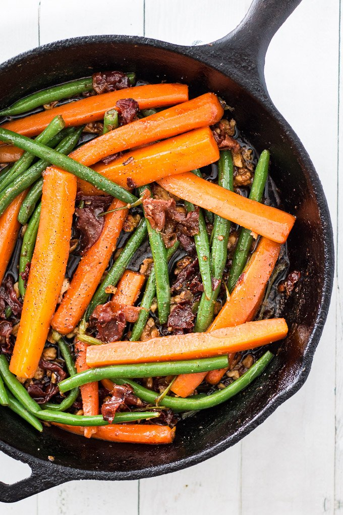 Sauteed Green Beans and Carrots in a cast iron skillet