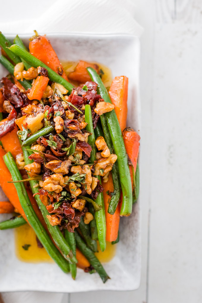 Sauteed Green Beans and Carrots served on a white plate