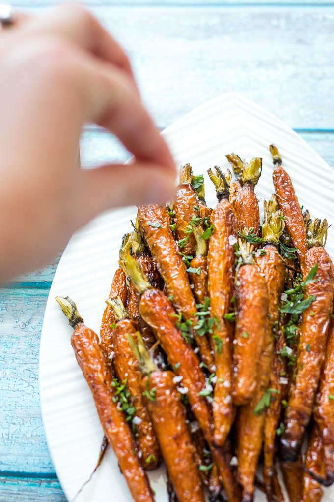 sprinkling salt on Dutch Carrots