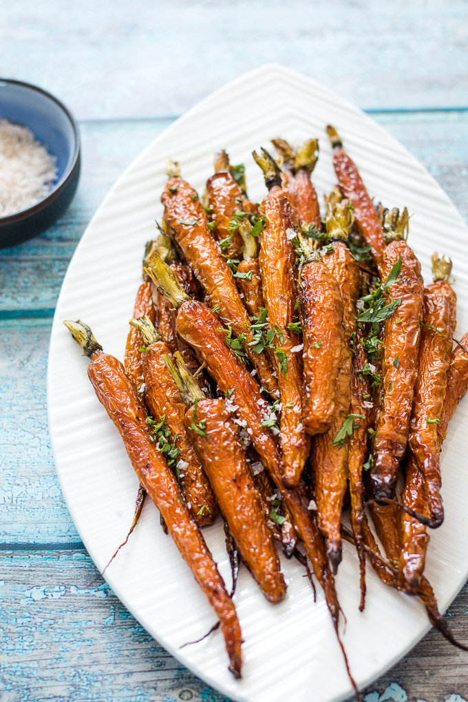 Roasted dutch carrots served on a white platter plate