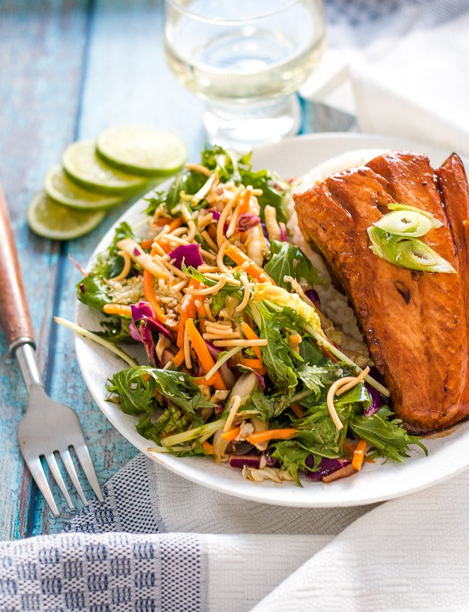easy teriyaki salmon on a white plate with slaw