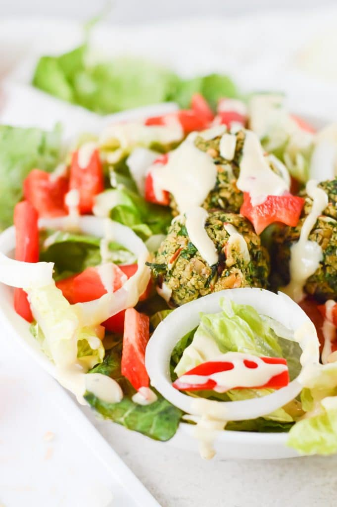 Homemade Falafel Bowls with falafel, lettuce, bell pepper, onion and a dressing