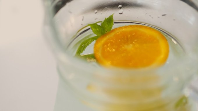 orange and mint in a large pitcher of water to make orange and mint infused water
