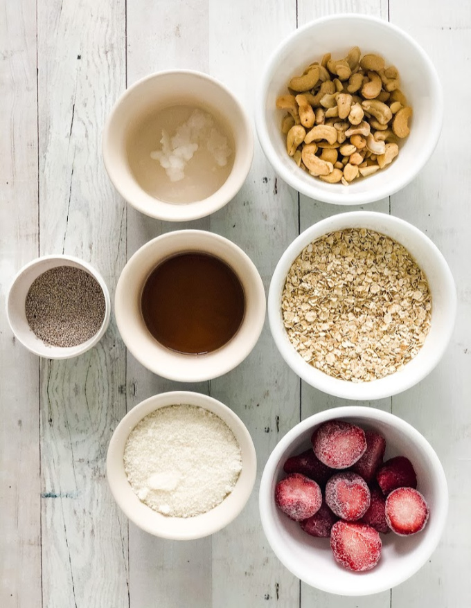 ingredients for strawberry balls laid out in 7 small bowls