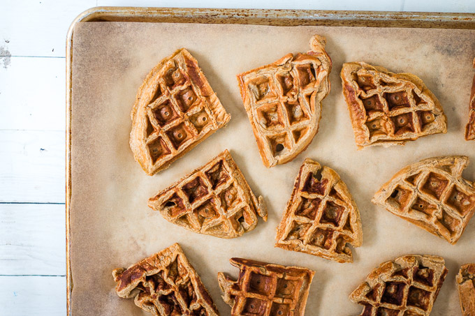 cooked waffles lying on a baking tray