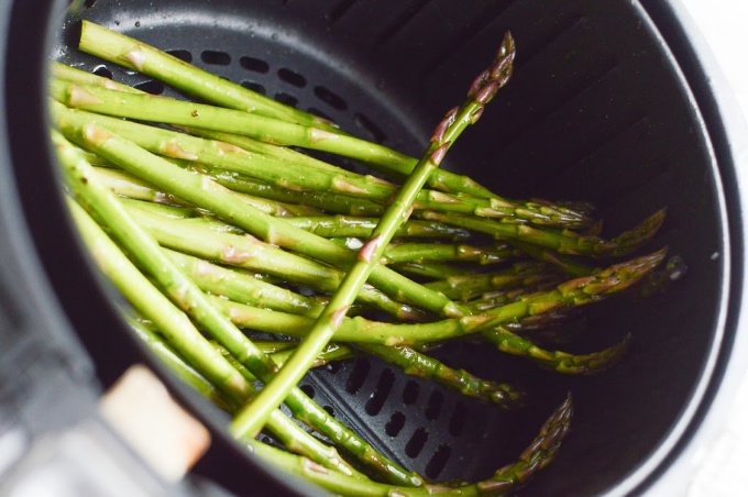 Asparagus in the tray of an air fryer
