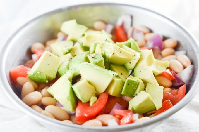 Add the avocado to the mixture for the white bean salad