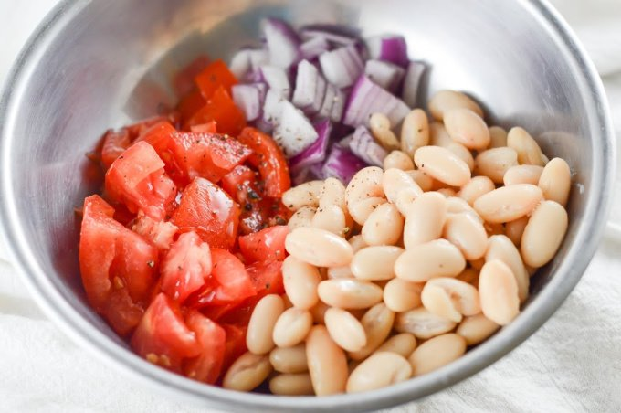Add all the ingredients for avocado white bean salad to a bowl
