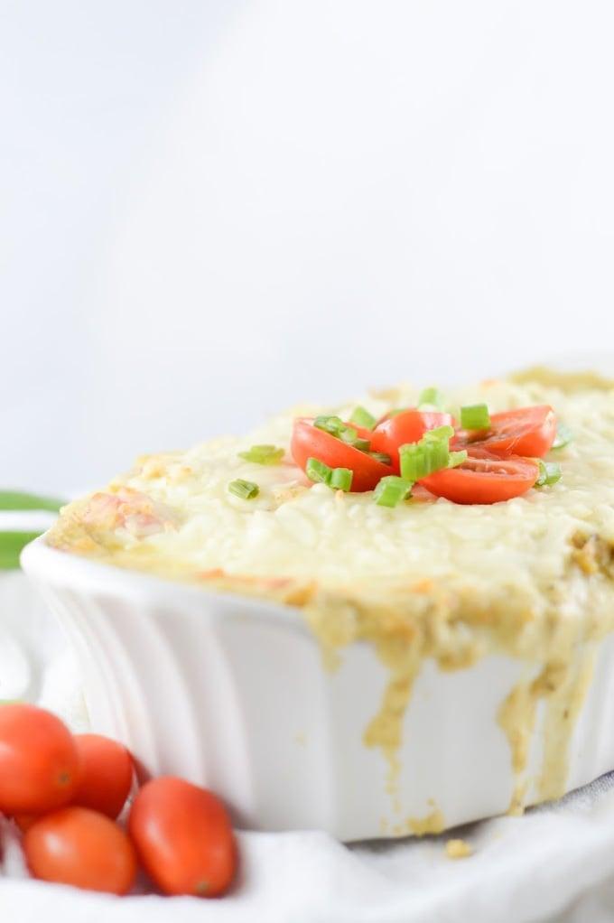 keto pesto cheese dip recipe in a white casserole dish