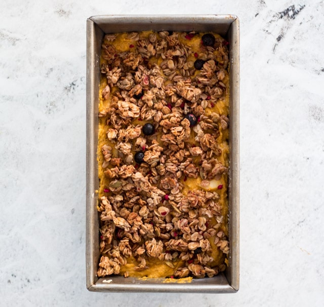 Top the pumpkin and apple bread batter with the granola