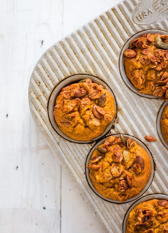 up close overhead shot of healthy pumpkin muffins in a muffin tin