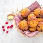 Basket full of sweet cranberry cornbread muffins