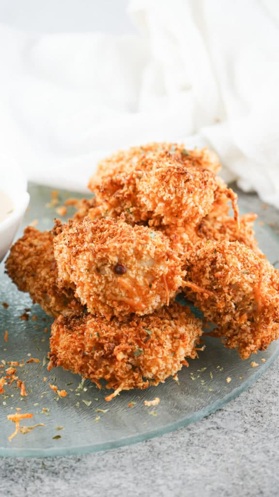 Up close shot of Air Fryer Chicken Nuggets piled onto a glass serving dish