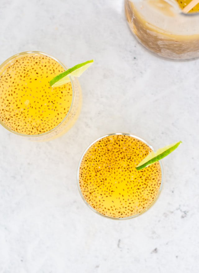 Pineapple chia water served in two glasses with a slice of lime on the side