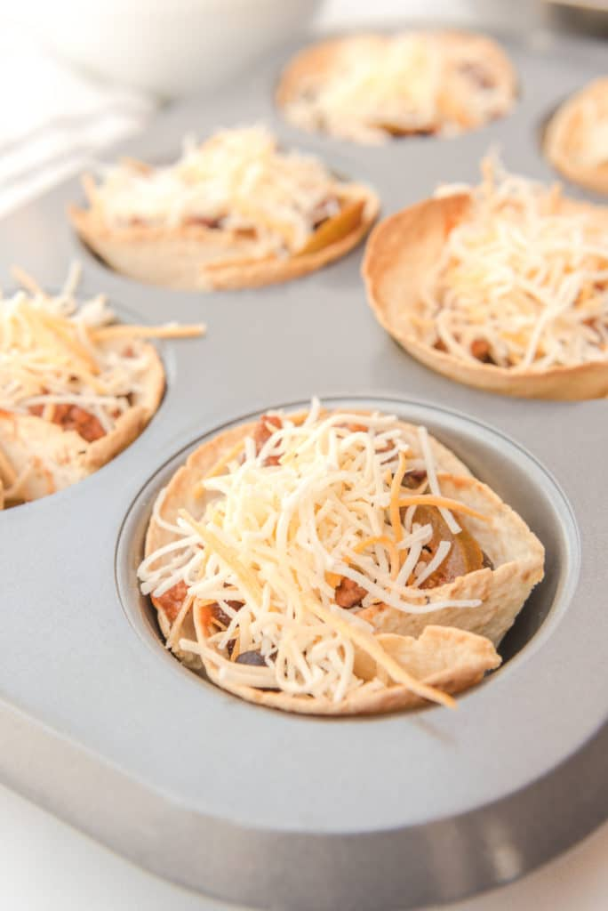 beef and bean enchiladas in a muffin pan