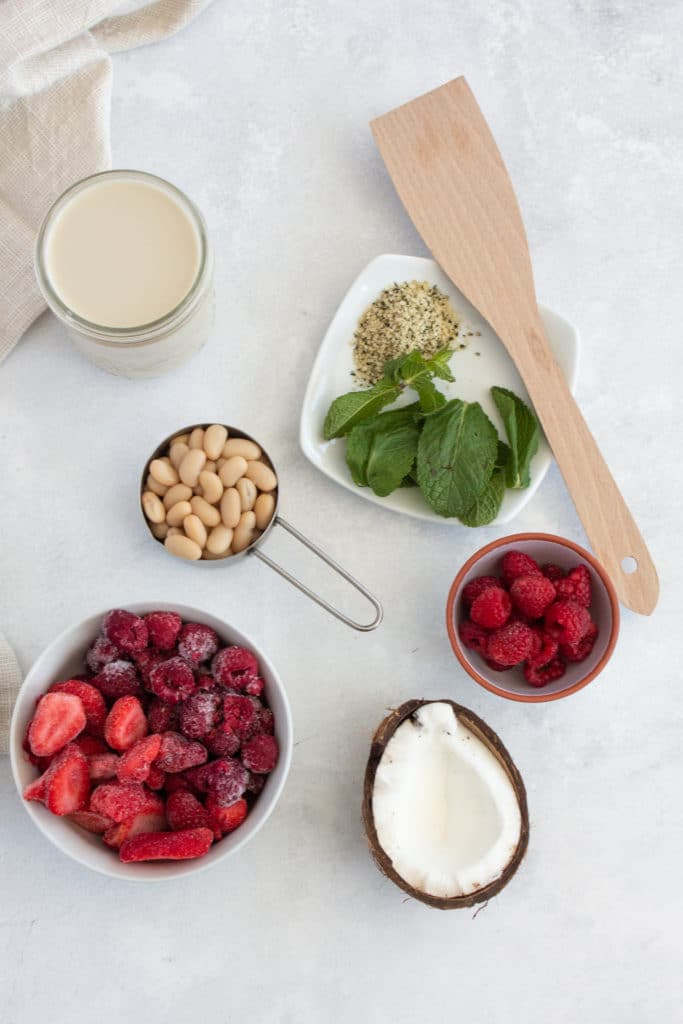 Overhead shot of ingredients for red berry smoothie