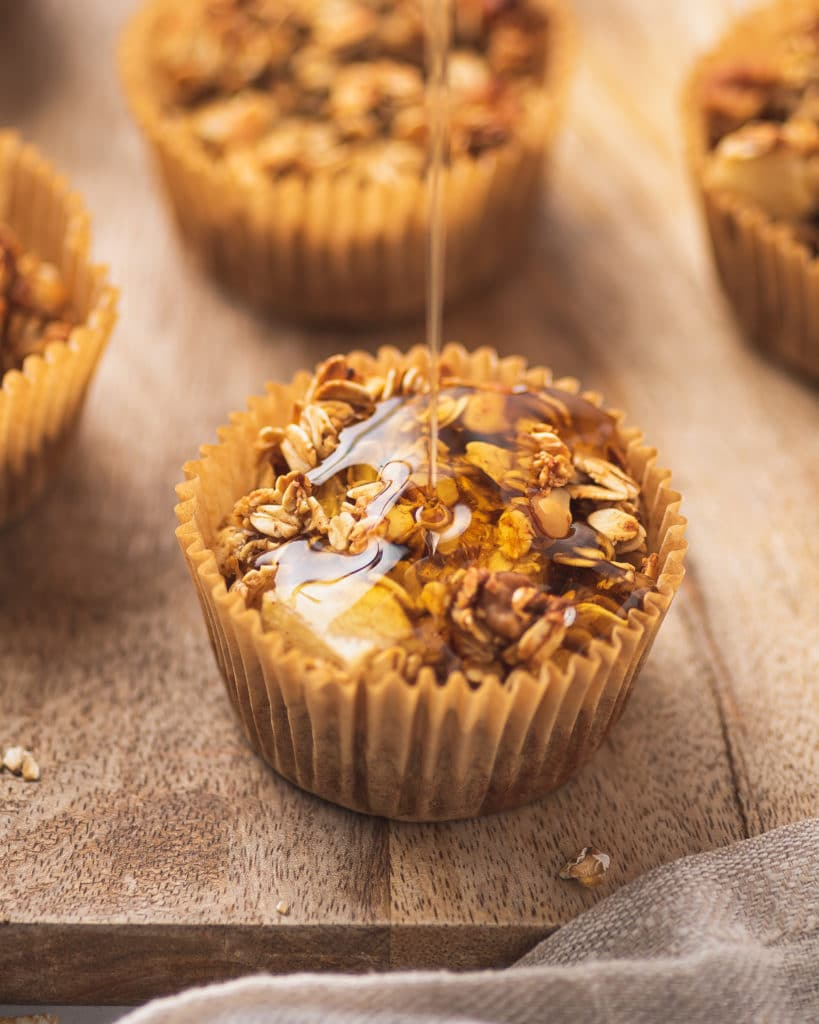 A drizzle of maple syrup on top of a apple cinnamon muffin