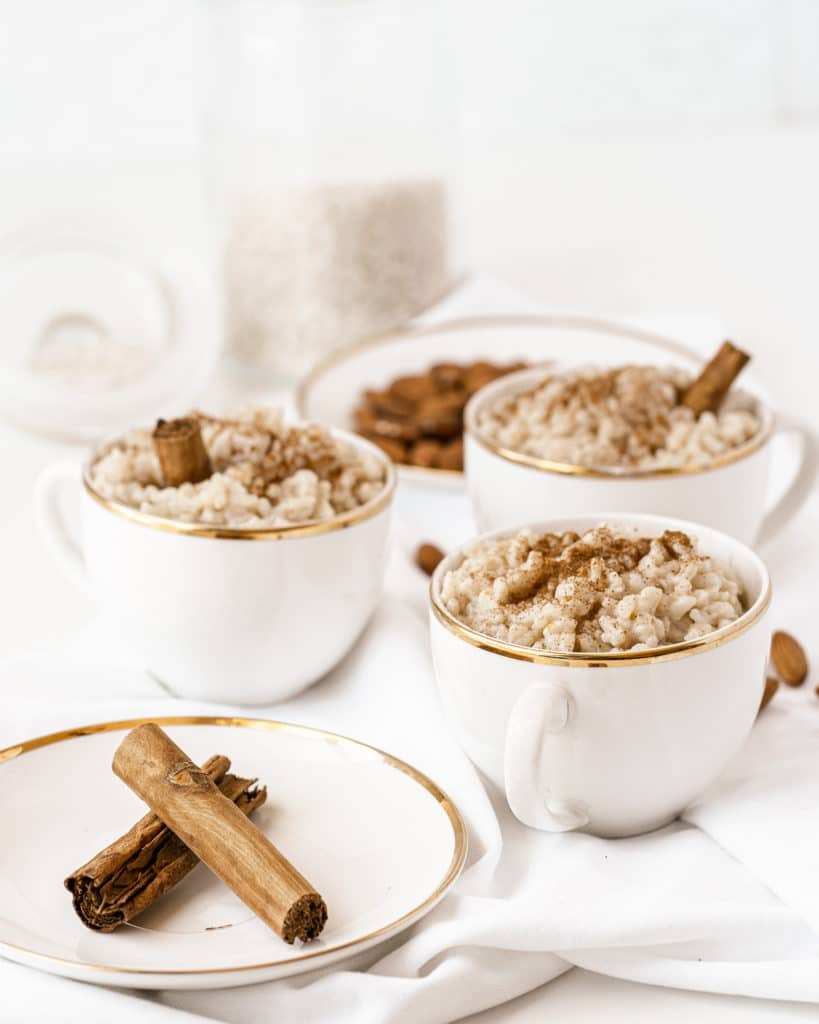 Easy rice pudding served in white and gold tea cups