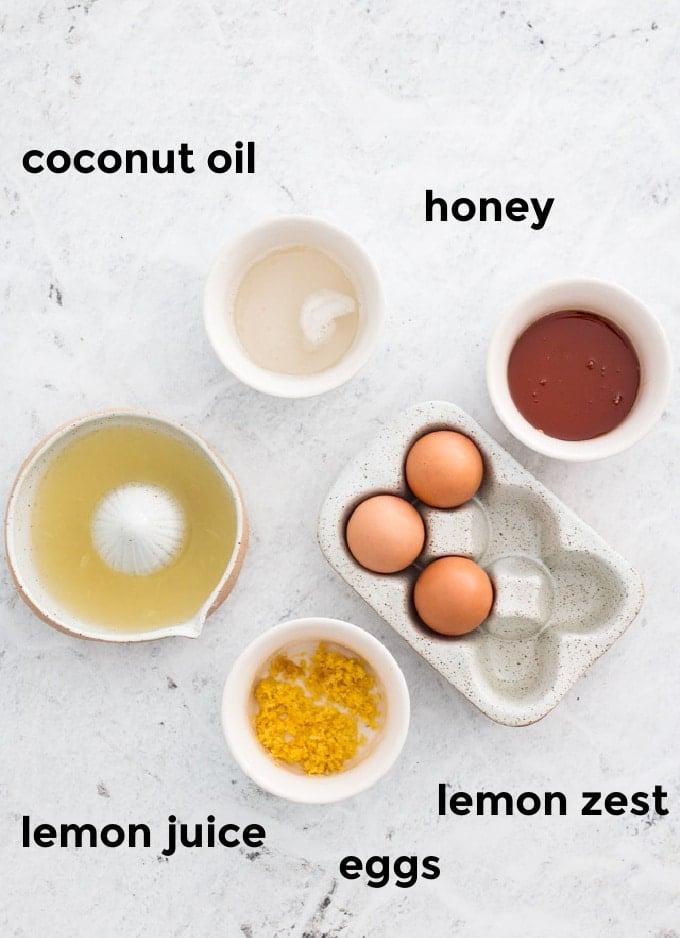 Overhead ingredient shot of ingredients needed for lemon curd with honey