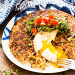 potato rosti topped with a poached eggs and a fresh tomato salsa