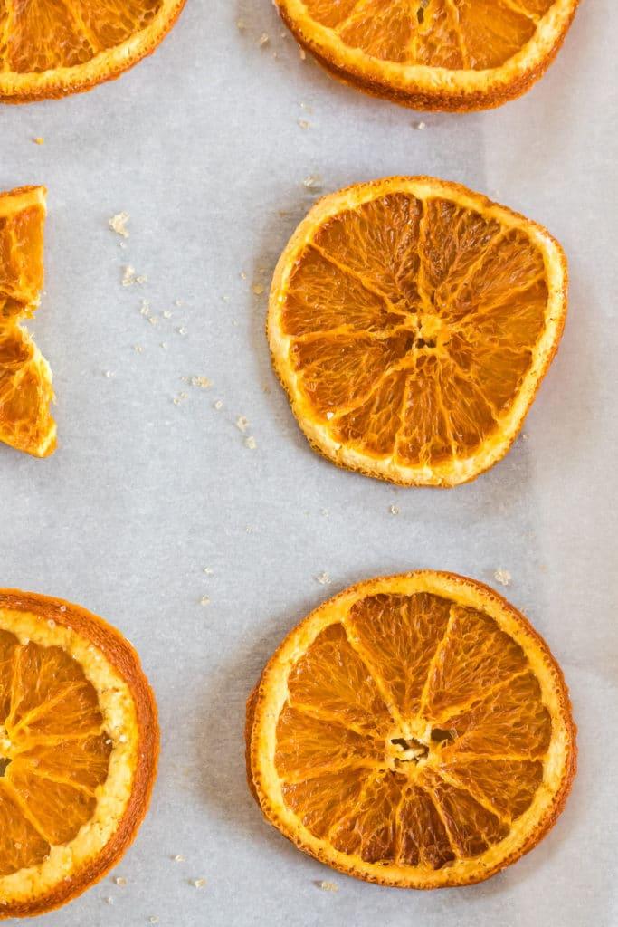 Baking sheet holding dehydrated orange slices