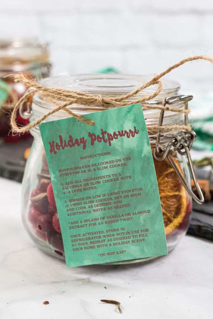 Gift tag with cooking instructions added to a glass jar of homemade potpourri