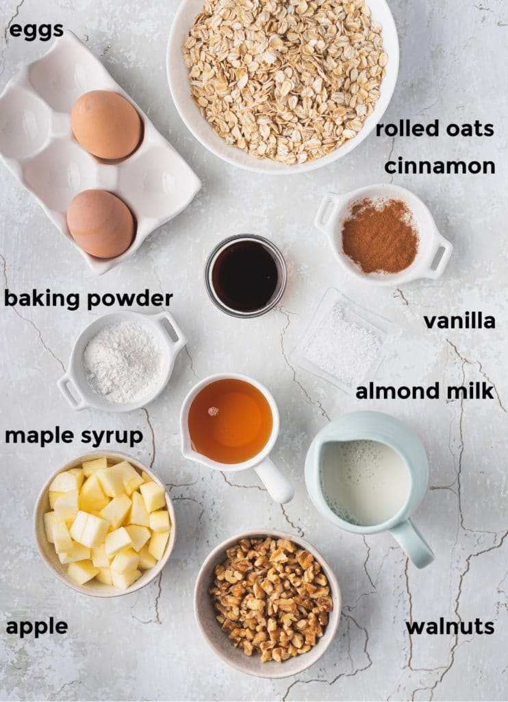 Overhead labelled shot of ingredients needed for apple cinnamon oatmeal cups