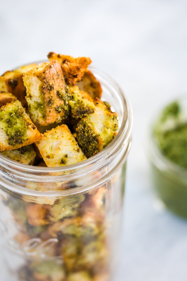 Up close shot of crunchy homemade croutons stored in a glass jar