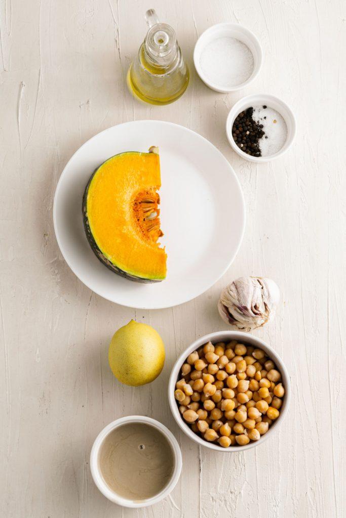 Ingredients for homemade pumpkin hummus in a food processor