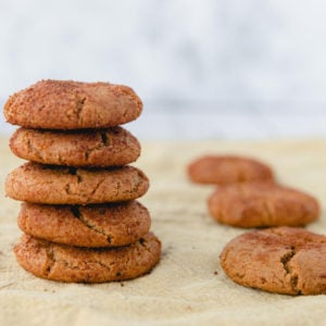 A stack of baked ginger cookies on a piece of parchment paper
