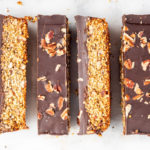 Overhead shot of a superfood bar topped with chocolate and nuts